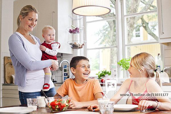 mMther and children having dinner