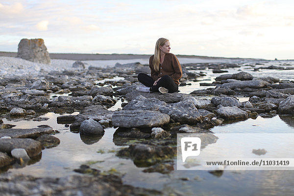 Woman looking at view  Faro  Gotland  Sweden