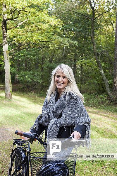 Senior woman with bicycle  Delsjon  Gothenburg  Sweden