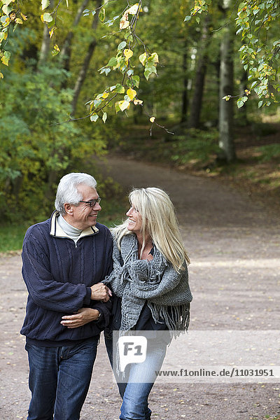 Senior couple walking through forest  Delsjon  Gothenburg  Sweden