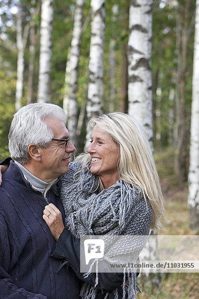 Senior couple hug in forest  Delsjon  Gothenburg  Sweden