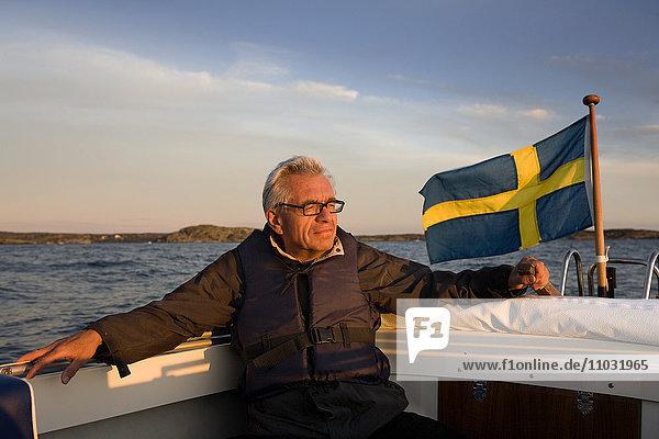 Senior man on boat  Sweden