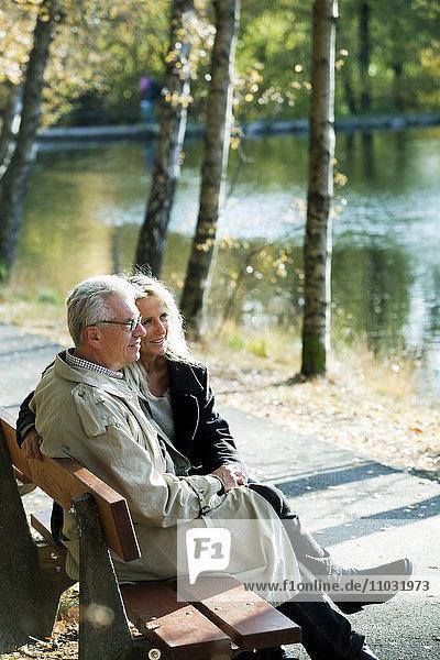 Senior couple sitting on park bench  Gothenburg  Sweden