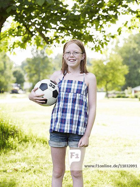 Girl posing with football