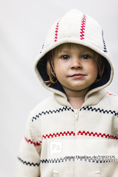 Portrait of girl wearing hoodie  studio shot