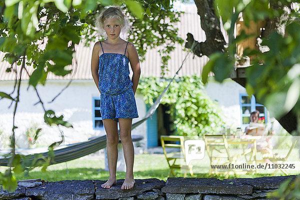 Girl standing on ledge