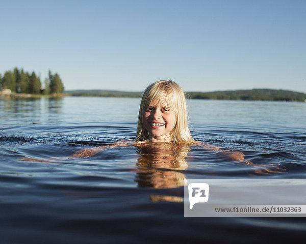 Girl swimming in lake  Siljan  Dalarna  Sweden
