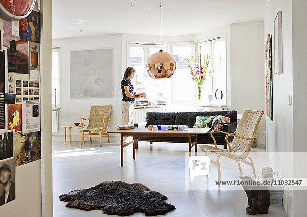 Mature woman in living room  Stockholm  Sweden