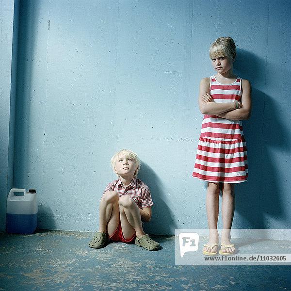 Boy and girl against blue wall  Lund  Skane  Sweden