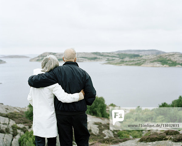 Senior couple looking at sea