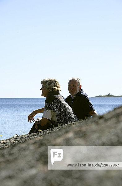 A senior couple by the ocean.
