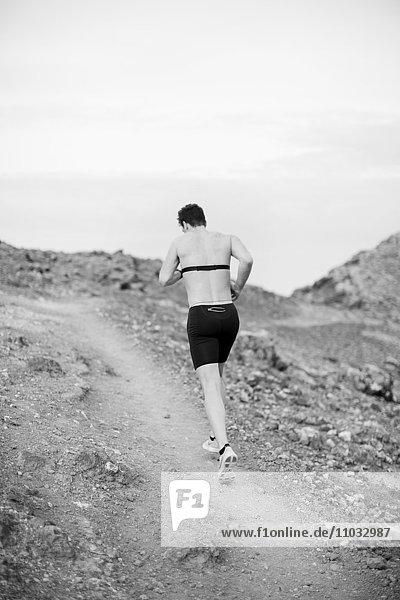 Mid adult man running  Lanzarote  Canary Islands  Spain