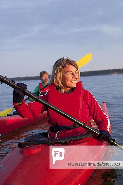 Two women kayaking on the sea