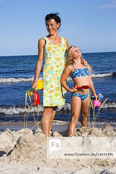 Mother and daughter on the beach.
