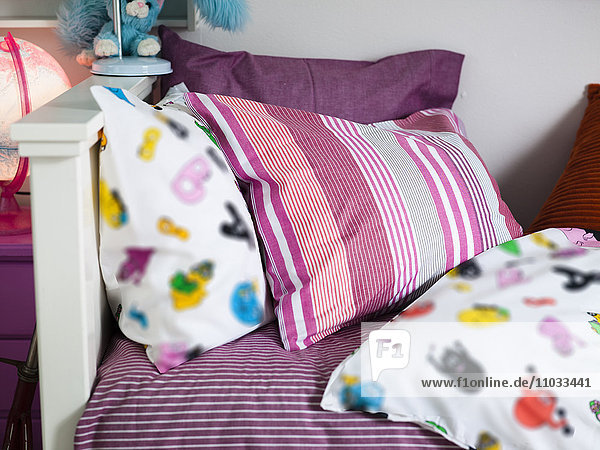 Close up of colorful bedding in nursery room