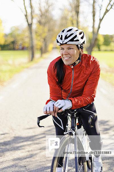 Portrait of woman riding bike
