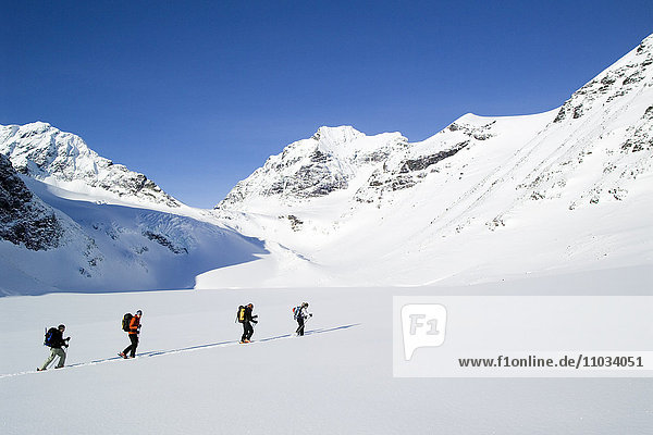 People skiing in the mountains.