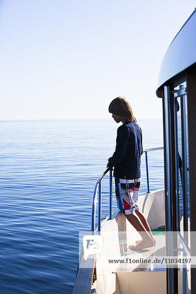 Boy on boat looking away