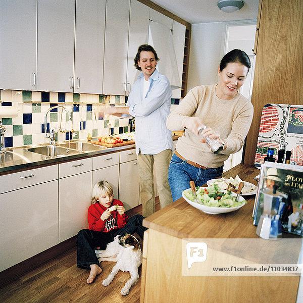 Scandinavian family making dinner in the kitchen  Sweden.