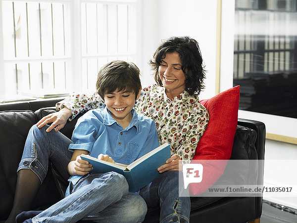Mother and son reading together.
