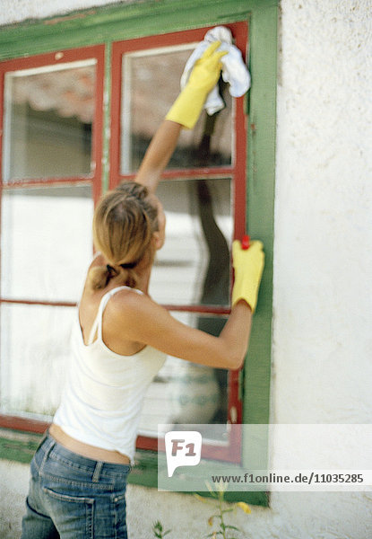 A woman cleaning windows.