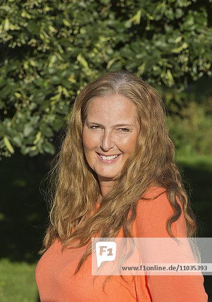 Portrait of mature woman outdoors