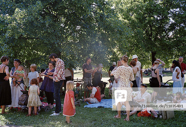 Family party in a park  Stockholm  Sweden.