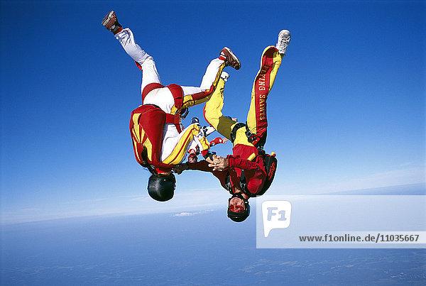 Parachute jumper in the air.