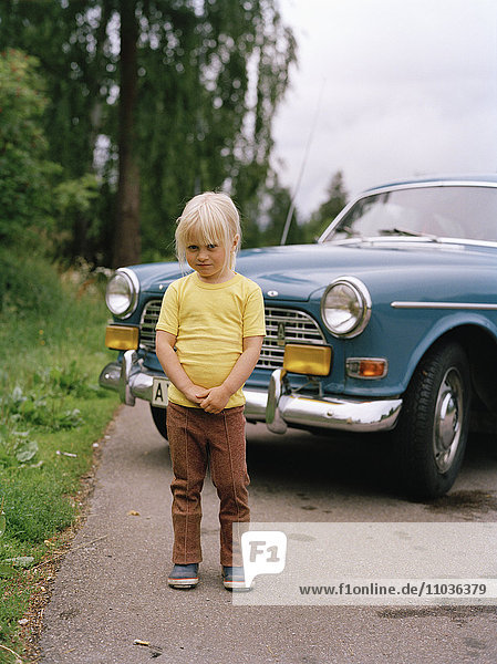 A girl in front of a Volvo Amazon  Sweden.