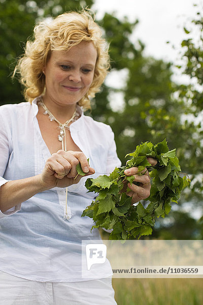 A woman celebrating Midsummer  Sweden.