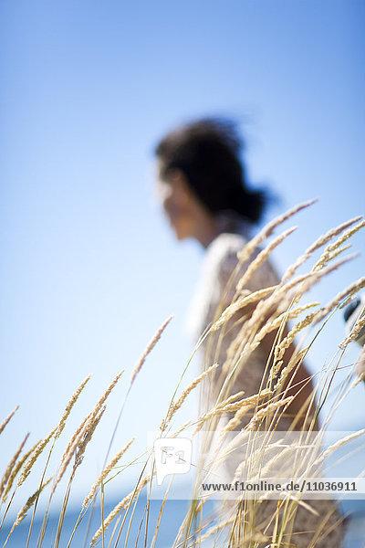 A woman walking by the sea  Sweden.