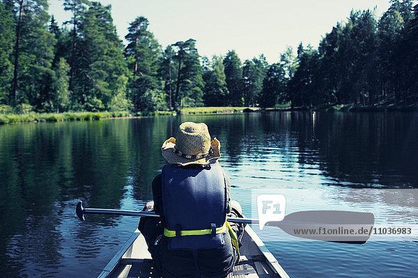 A boy canoeing  Sweden.