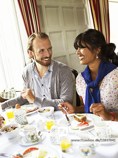 Man and woman eating breakfast  Sweden.