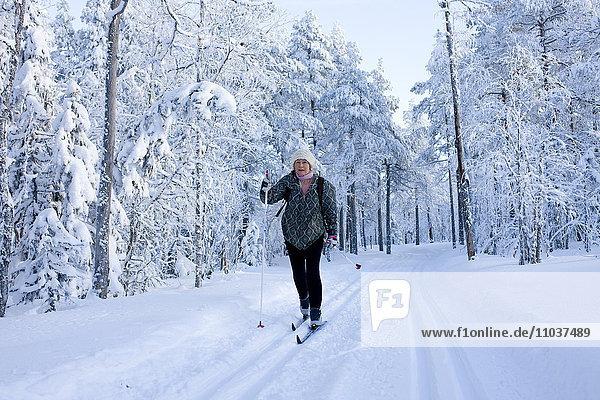Woman skiing  Sweden.