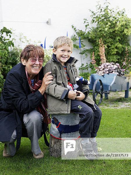 Grandmother and grandson in a garden  Sweden.