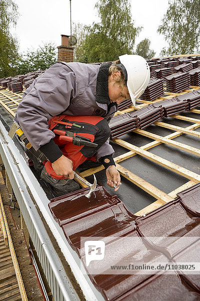 A young man roofing  Sweden.