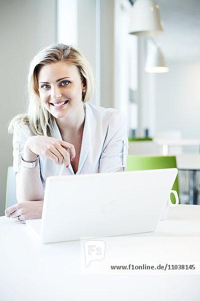 Blond woman using a laptop  Sweden.