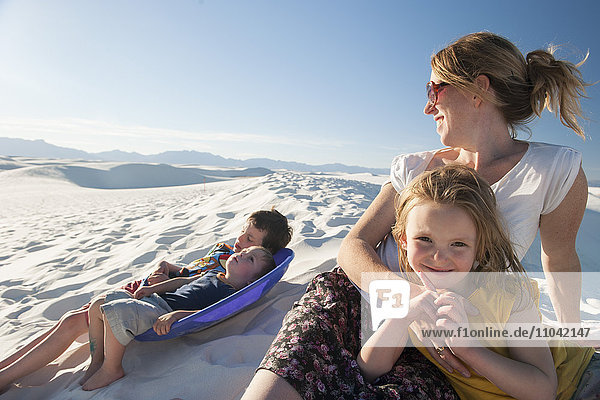 Family relaxing together at White Sands National Monument  New Mexico  USA