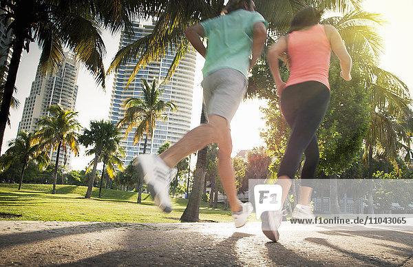 Legs of Caucasian women jogging in city