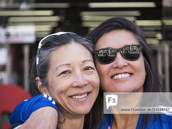Japanese women posing cheek to cheek