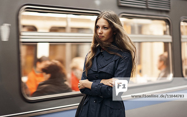 Caucasian woman waiting for subway train