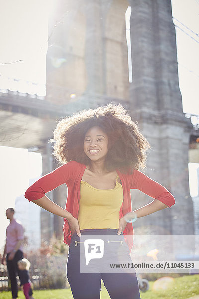 Smiling Black woman posing with hands on hips