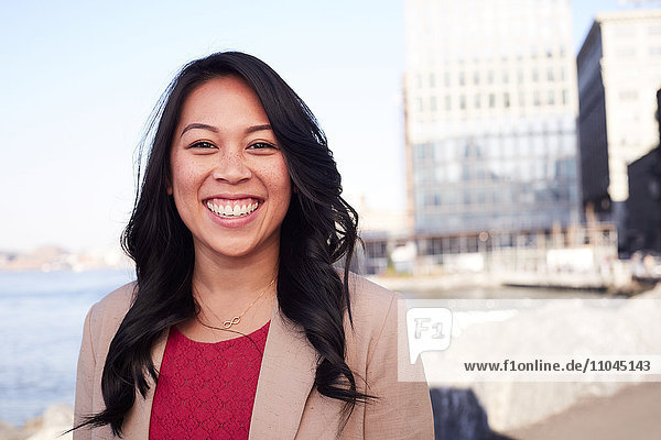 Pacific Islander woman smiling at waterfront