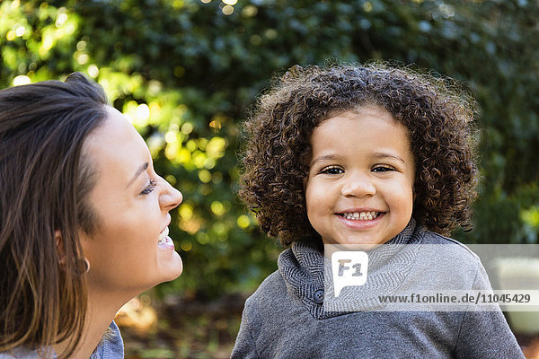Mother and son smiling outdoors