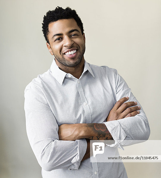 African American businessman smiling with arms crossed