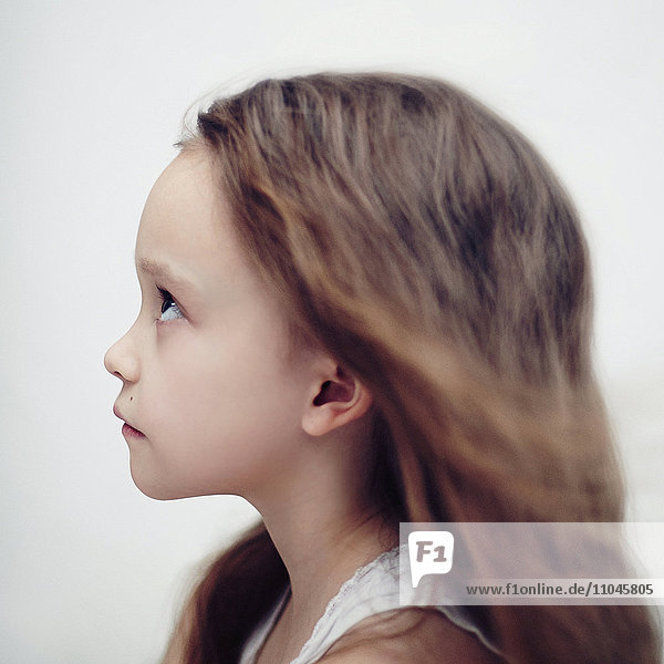 Profile of Caucasian girl looking up