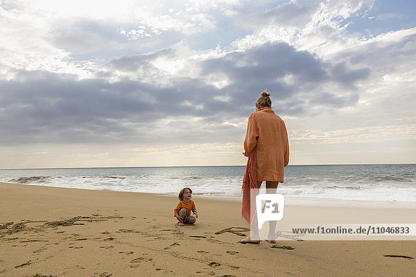 Caucasian mother and son on beach