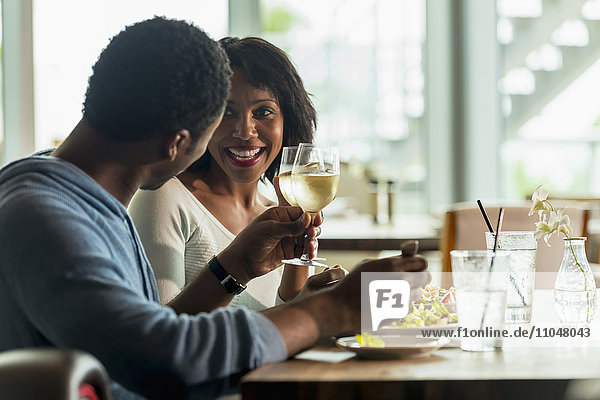 Couple drinking wine at lunch in cafe
