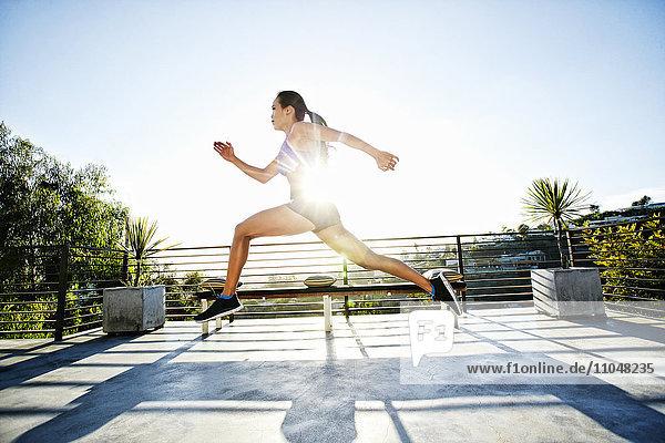 Chinese athlete running on balcony