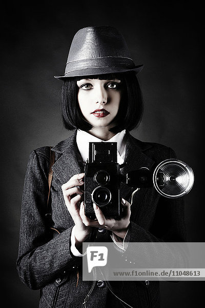 Caucasian photographer using vintage camera